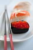 Sushi with salmon caviar and salmon