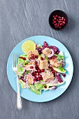 Slad with tuna insesame, pomegranate, avocado and red onions