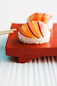 Sweet nigiri sushi with delicate slices of fruit