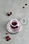 Dried rose petals in a medicine jar