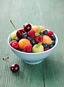 Fruit salad with berries, melon balls and cherries