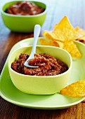Spicy courgette salsa with tortilla chips