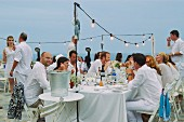 Wedding guests at a wedding party by the sea
