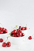Fresh cherries in white cups