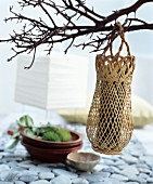 Oriental-style decoration idea: a woven vase hung on a twig