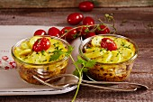 White cabbage and potato bakes with cherry tomatoes