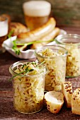White cabbage with apples as a side dish with sausage and beer