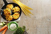 Pasta and vegetable fritters with ingredients