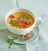 Cold carrot and almond soup with croutons and parsley