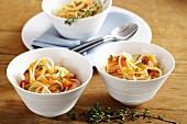 Spaghetti with salmon and tomato sauce