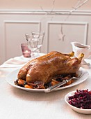 A whole duck with dried fruit and red cabbage