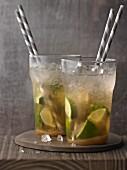 Two Caipirinhas with straws