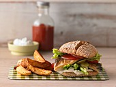 Fish burger with potato wedges
