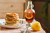 A stack of pancakes with maple syrup
