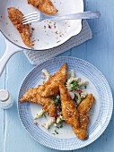 Chicken goujons with a coconut and sesame seed coating and a pasta salad