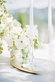 White posy and candles on outdoor wedding table (Ravello, Italy)