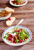 Lamb's lettuce with ham crisps and raspberries