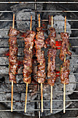 Lamb skewers on a barbecue (seen from above)