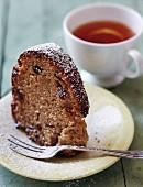 A slice of Bundt cake served with tea