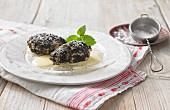 Apple and quark dumplings with poppyseeds and vanilla sauce