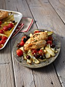 Fennel with chicken breast baked on a tray