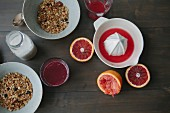 Blood orange juice, muesli and milk