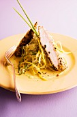 Rabbit fillet with a nori and sesame seed crust, wasabi and cabbage salad and aioli