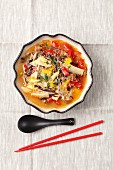 Spicy sour soup with duck, bamboo shots, peppers, Chinese mushrooms and noodles
