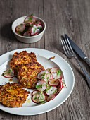 Vegan carrot and kohlrabi cakes with a radish salad