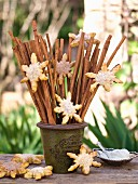 Bunch of sticks decorated with snowflake biscuits