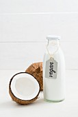 Coconut milk in a glass bottle with a label