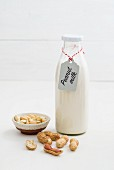 Peanut milk in a glass bottle