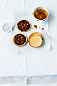 Chocolate and caramel tartlets with flakes of salt