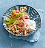 Quinoa muesli with fresh figs, grapes and soured milk