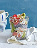 Crunchy chia seed muesli with kiwis, strawberries and grated coconut