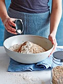 Spelt wholemeal bread being made: ingredients being mixed in a bowl