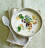 Cream of parsnip and potato soup with pumpkin seed gremolata