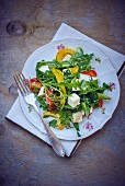 Rocket salad with goat's cheese and peppers