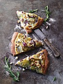Vegetarian potato pizza with red onions, feta cheese and rosemary