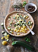 Diced potatoes and courgettes on a wholemeal tart base