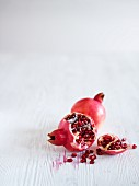 Pomegranates, whole and sliced open