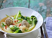 Oriental soup with bok choy, rice and beef meatballs