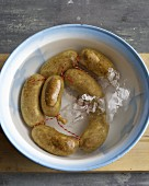 Sausages in a bowl of iced water