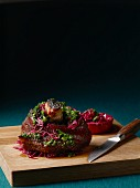 Slow roasted pork knuckle with kale escabeche and red cabbage
