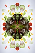 A digital composite of mirrored images of a mixed vegetable salad
