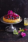 Gluten-free berry cake with edible flowers