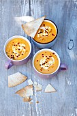 Cream of pumpkin soup with curry and tortilla crisps