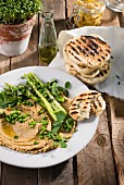 Grilled flatbreads with hummus and spring vegetables