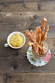 Pork crackling sticks as a snack with an apple dip
