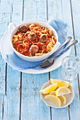 Tagliatelle with tuna balls and tomato & caper sauce